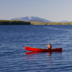 A canoeist enjoys paddling on Seboeis Lake, which is part of the Seboeis Public Reserved Lands Unit managed by the Maine Bureau of Parks and Lands, under the Maine Department of Conservation. The state on Monday, April 30, 2012 completed acquisition of more than 5,700 acres of land to the unit, including two miles of lake shoreline.