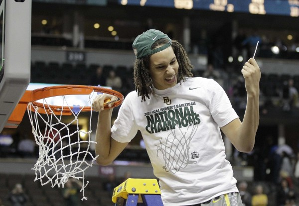 Baylor center Brittney Griner cuts the net down after the NCAA women's basketball championship game against Notre Dame in Denver Tuesday night, April 3, 2012.  Baylor won the championship 80-61.