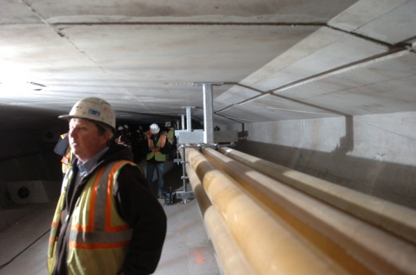 Charlie Guerette, Reed & Reed Inc.'s project manager for construction of the new Veterans Memorial Bridge, fields questions from reporters in the maintenance and utility tunnel running through the new bridge on Tuesday, April 10, 2012. Work on the bridge connecting Portland with South Portland over the Fore River began in 2010 and will conclude this summer.