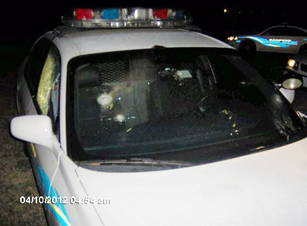 This photo provided by the Sanford Police Department shows a police cruiser Tuesday, April 10, 2012, after it was shot in Sanford, Fla. Authorities say gunfire knocked out a window on the car parked near the townhome community in Florida where unarmed black teen Trayvon Martin was shot to death by a neighborhood watch volunteer. Sanford police told Orlando television station WKMG the cruiser was found with at least two bullet holes Tuesday morning after witnesses reported hearing at least six gunshots.