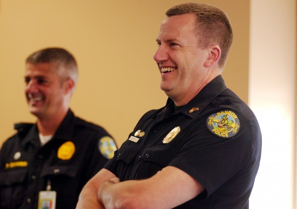 Thomas Reagan (right) listens alongside Sgt. Paul Edwards as Bangor Police Chief Ron Gastia (not pictured) announces Reagan's promotion at the Bangor Police Department in May 2007.