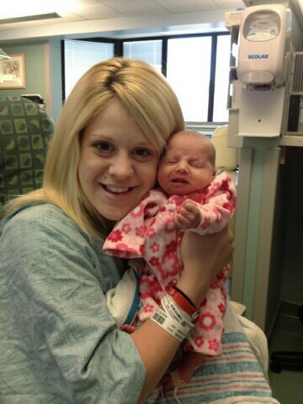 In this undated photo provided by the family, Aileen Dannelley holds her baby, Savannah, at Advocate Christ Medical Center in Oak Lawn, Ill. The one-month-old baby is being treated with methadone for withdrawal while she and her mother both fight addiction to powerful prescription painkillers.