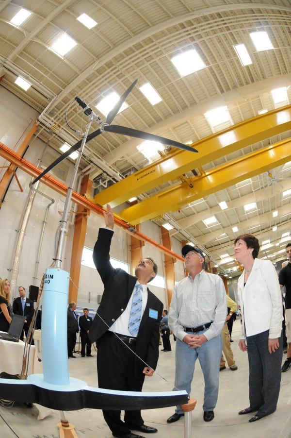 In this August  2011 photo provided by the University of Maine, Habib Dagher, director of the University of Maine's Advanced Structures and Composites Center, left, shows U.S. Interior Secretary Ken Salazar and Sen. Susan Collins a scale model of a floating wind turbine in Orono, Maine. A $3 million federal grant will be used for a component lab that will build prototype blades, towers and hulls for floating windmills. (AP Photo/University of Maine)