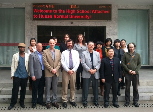 Orono High School teachers arrive to a warm welcome at the high school attached to Hunan Normal University. Pictured are Peter Buehner, Jim Bulteel, Jim Chasse (front row 2-4 from left), Mackenzie Grobmyer and Chris Crocker (back row, 3-4 from left)