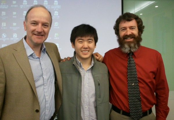 Orono High School AP English teacher Jim Bulteel, OHS and Harvard graduate Mike Zhang and AP math teacher Chris Libby pose for a photo after presenting to the parents, students and teachers of the High School attached to Hunan Normal University.
