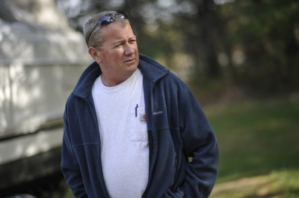 Jim McDougal walks outside his home on Grand Road in Orrington on Monday, April 30, 2012. McDougal is frustrated about the  traffic in and out of the gravel pit abutting his house.