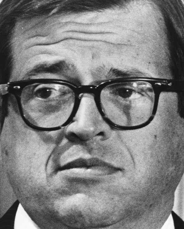 Former White House attorney Charles Colson talks to reporters on March 1, 1974, after he was charged in the Watergate cover-up in Washington.
