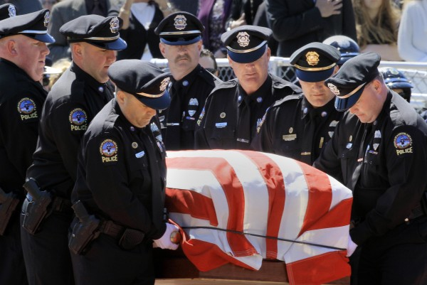 Greenland police carry the body of their chief during a memorial service for Police Chief Michael Maloney, on Thursday, April 19, 2012 in Hampton, N.H.  Maloney was days away from retirement when he was fatally shot last Thursday. He and other officers were trying to serve a warrant.