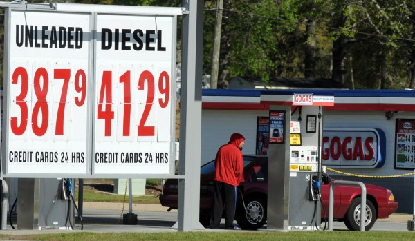 Robert Ward of Leland, N.C. pumps gas at GOGAS in Leland Tuesday, March 27, 2012.