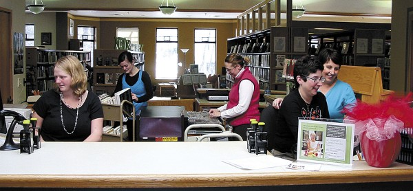 Working behind the circulation desk at the Old Town Public Library are (from left) Meahgan King, Cassandra Arey, Lynn Uhlman, Samantha Ryan and director Cynthia Jennings.