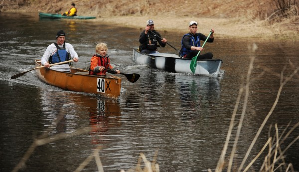 Competitors in the Passagassawakeag Stream Canoe Race paddle go side by side on flat water on Saturday, April 7, 2012. The race course was cut in half and racers had to paddle back up stream to the finish due to low water.