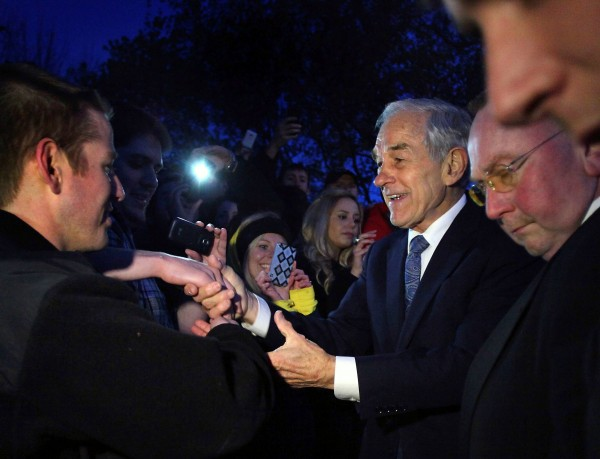 Republican presidential candidate Ron Paul shakes hands at a campaign event at the University of Wisconsin campus in Madison, Wis., on Thursday, March 29, 2012.