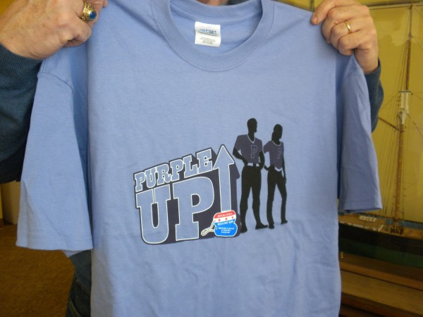 "Local National Guard members are selling ""Purple Up!"" T-shirts for $10 in support of Maine's Operation: Military Kids event to &quotPurple up! For Military Kids&quot event Friday."