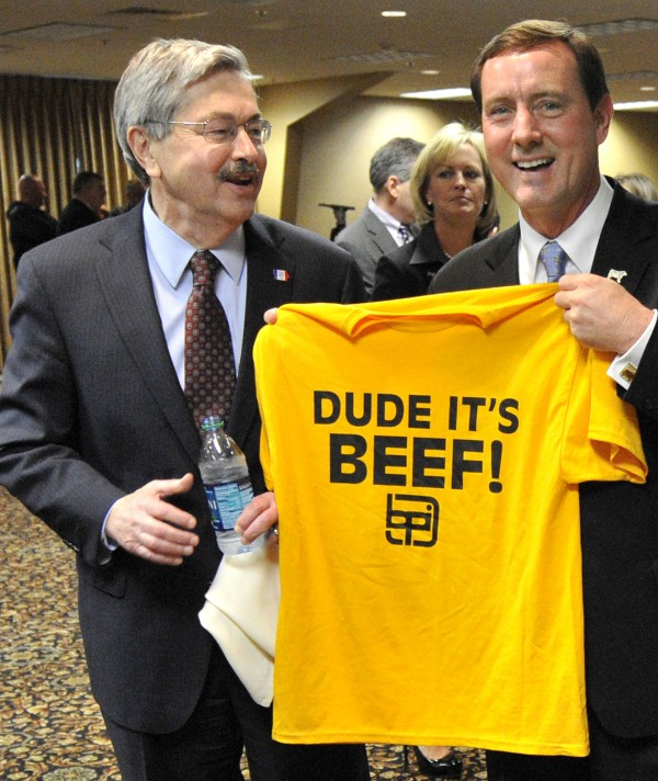 In this Thursday, March 29, 2012, photo, Iowa Gov. Terry Branstad (left) and Neb. Lt. Gov. Rick Sheehy mug for cameras while holding a T-shirt after a press conference in South Sioux City, Neb. The governor of Iowa says he wants a congressional investigation into how what he called &quota smear campaign&quot against the meat product commonly called &quotpink slime&quot got started.