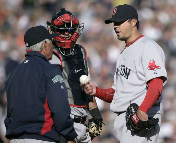Boston Red Sox starter Josh Beckett, right, gives up the baseball to manager Bobby Valentine, left, as catcher Jarrod Saltalamacchia looks on in the fifth inning of a baseball game Saturday, April 7, 2012, in Detroit. Beckett was relieved after giving up back-to-back home runs to Detroit's Miguel Cabrera and Prince Fielder.