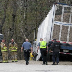 Pulp truck rolls over in Rumford, driver blinded by sun