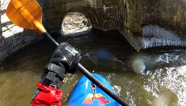 Getting a peak from the paddlers point of view as Gabor Degre approaches the pipe on the far left of the Flour Mill drop on the Kenduskeag Stream.
