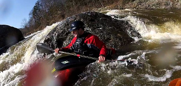 Nicholas Wood waits in the eddy formed behind a boulder at the rapid paddlers refer to as &quotthe corner&quot below the Valley Avenue Bridge drop on the Kenduskeag Stream.  The stream iced out unusually early making this March 13th run possible.
