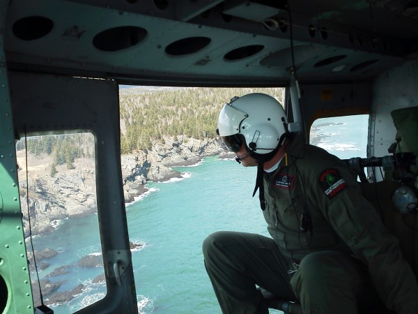 Ranger Jeff Currier of the Maine Forest Service overlooks the rescue area where a hiker with an injured leg was airlifted from the Bold Coast Trail in Cutler on Sunday afternoon.
