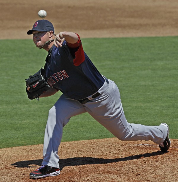 Boston Red Sox starting pitcher Jon Lester delivers in the first inning of the Red Sox 6-0 shutout of the Philadelphia Phillies during their spring training baseball game in Clearwater, Fla., Monday, March 26, 2012.