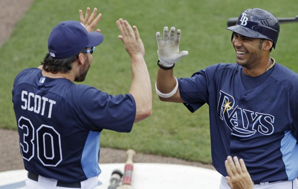 Tampa Bay Rays' Carlos Pena (right) is congratulated by teammate Luke Scott after his solo home run against the Boston Red Sox during a spring training game. The Rays open their season Friday afternoon when they host the New York Yankees.