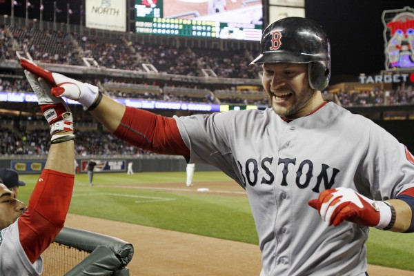 Boston's Cody Ross celebrates his two-run, game-tying home run off Minnesota Twins pitcher Jason Marquis in the seventh inning Monday night in Minneapolis. The Red Sox won 6-5.