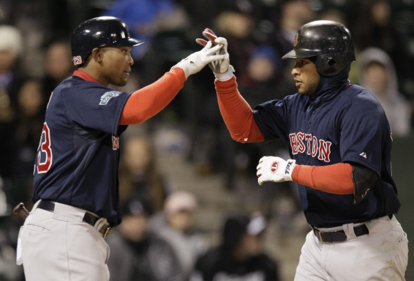 Boston Red Sox's Darnell McDonald, right, celebrates with Marlon Byrd after hitting a solo home run during the ninth inning against the Chicago White Sox in Chicago, Friday, April 27, 2012. The Red Sox won 10-3.
