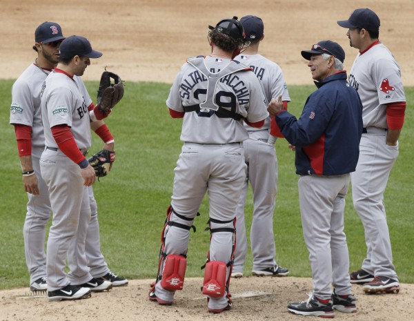 Boston Red Sox manager Bobby Valentine, front right, talks to his team during the eighth inning of an baseball game against the Chicago White Sox in Chicago, Sunday, April 29, 2012. The White Sox won 4-1.