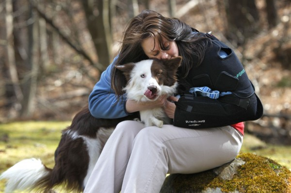 Roosevelt gets a hug from his owner, Stephanie Fox, Saturday, April 7, 2012, in Portland. &quotPeople say, 'Oh, the poor thing.' But he wakes up happy every day. He doesn't know he's different.&quot