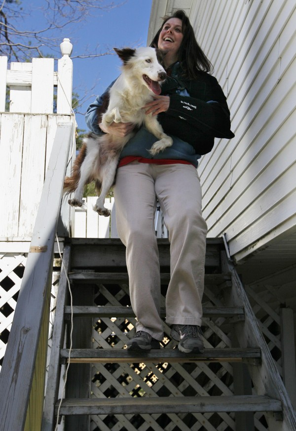 Stephanie Fox carries Roosevelt at her home, Saturday, April 7, 2012, in Portland. &quotHe doesn't like to go down stairs because he can't control his balance,&quot Fox said. &quotBut he really will do anything else, once he knows he won't get hurt.&quot