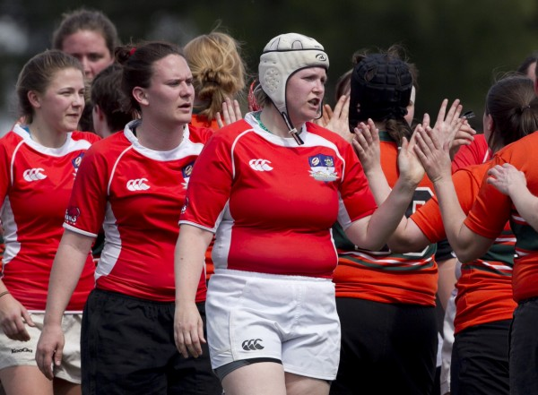 Portland's Patty Williams (wearing scrum helmet) leads her teammates in congratulating their Charles River opponents after a match Saturday, April 14, in Portland. &quotWhat happens on the field stays on the field,&quot said team club president Brittney Braasch.