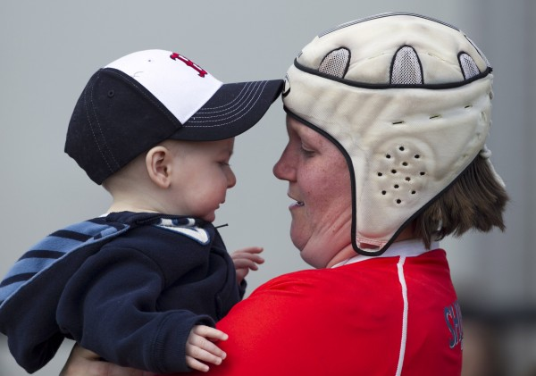 Portland's Patty Williams picks up her seven-month-old son, Patrick, after playng in two rugby matches Saturday, April 14, in Portland. &quotI couldn't imagine a Saturday without rugby,&quot she said.
