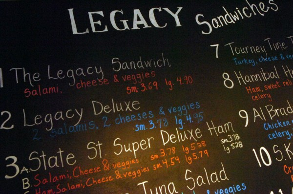 The menu board in Legacy Sandwich on State Street in Bangor shows a variety of different sandwiches, including varieties of one of their big draws, the Legacy sandwich. The Coffee Pot Cafe on Broadway in Bangor has sued competitor Legacy Sandwich, alleging that Legacy Sandwich is infringing on the Coffee Pot Cafe's trademark by using the words &quotDeluxe,&quot &quotSuperdeluxe,&quot and &quotCoffee Pot.&quot