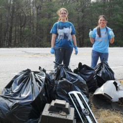 Unity College students Kieu Tran and Michelle Plance help with a roadside spring cleaning at Sebasticook Regional Land Trust's Kanokolus Bog Preserve in Unity.