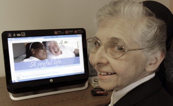 Sister Elaine Lachance works at a computer displaying a photo from the St. Joseph convent in Biddeford on Tuesday, April, 10, 2012. Good Shepherd Sisters of Quebec has just six convents in Maine and Massachusetts with fewer than 60 sisters. Sister Lachance is using the Internet, social media and a blog to attract women who feel the calling to serve God.