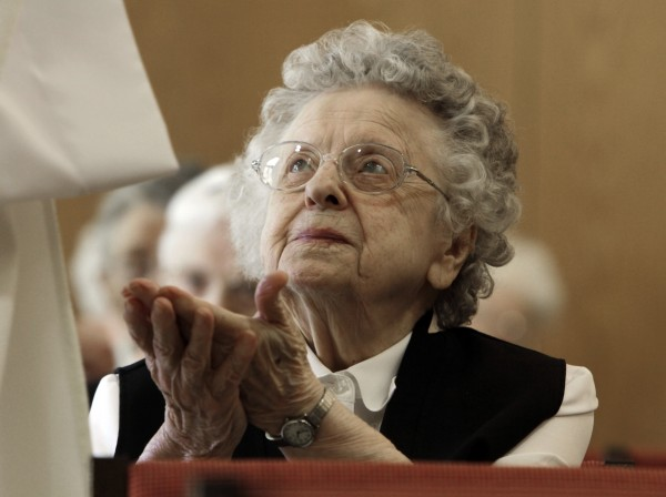 Sister Bertha Duperry, 96, reaches out to take communion during Mass at St. Joseph Convent n Biddeford on Tuesday, April, 10, 2012.