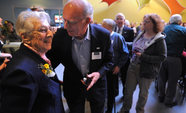 Clara Swan, a 1933 Husson graduate, talks to Larry Richard from the Class of 1956 during a party celebrating Swan's 100th birthday at Husson University in Bangor. Swan reminded people that the Titanic sank and the Boston Red Sox was founded the same year she was born.
