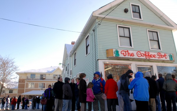 A line of loyal customers wraps around the Coffee Pot on State Street in Bangor on one of its final days in business in December 2009.