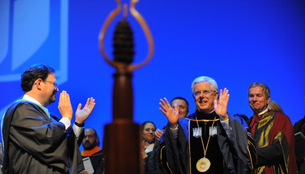 Paul Ferguson (second from right) acknowledges applause after he was inagurated as the 19th president of the University of Maine in Orono Thursday morning.