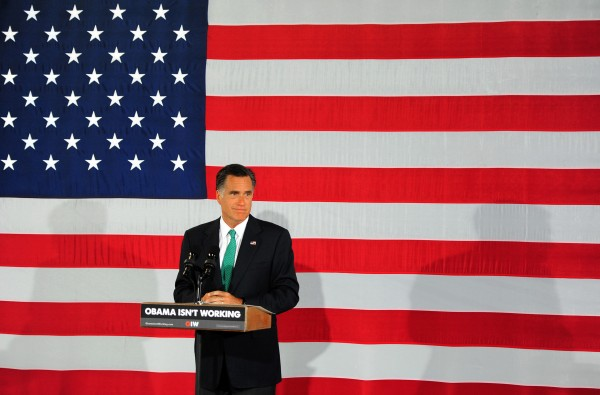 Republican presidential candidate Mitt Romney pauses during his address at A Roof with a View, a fifth-floor rooftop venue in Charlotte, North Carolina, on Wednesday, April 18, 2012. The Romney campaign chose the spot because it is near Bank of America Stadium where President Obama will give his acceptance speech to cap the Democratic convention.