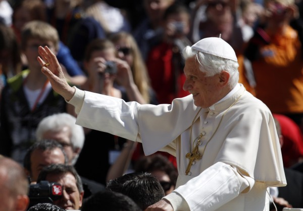 Pope Benedict XVI blesses faithful while touring St. Peter square during the weekly general audience at the Vatican, Wednesday, April 18, 2012.