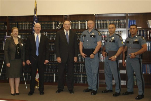 Patricia Poulin (from left), assistant district attorney for Kennebec County, Brent McSweyn of the ATF, U.S. Attorney Thomas E. Delahanty II, Maine State Troopers Mark Barney, Christopher Hashey and Jeffrey Mills after a ceremony Thursday in Bangor. Delahanty honored 32 individuals and agencies for their outstanding service to crime victims and law enforcement.
