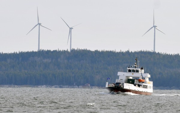 Three wind turbines loom over a ferry boat returning from Vinalhaven in 2009.