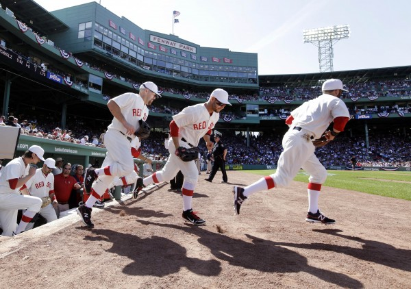 Boston Red Sox players take the field for a baseball game against the New York Yankees in throw-back uniforms of 1912 at Fenway Park in Boston on Friday, April 20, 2012. The Red Sox are celebrating  the100th anniversary of the first regular-season game at Fenway Park.