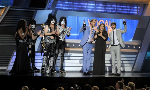Musical group KISS presents the vocal group of the year award to musical group Lady Antebellum at the 47th Annual Academy of Country Music Awards on Sunday, April 1, 2012 in Las Vegas. From left, Eric Singer, Paul Stanley, Tommy Thayer, Charles Kelley, Hillary Scott and Dave Haywood.