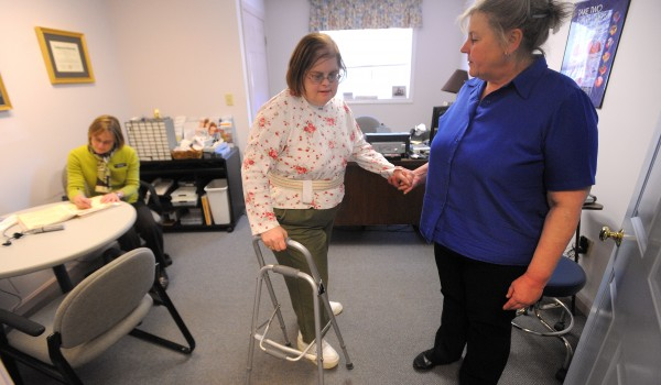 Sonja Burns (right) helps Vicki Ritchie turn around after she was checked by audiologist,  Dr. Carolyn Gaiero (left) Tuesday in Belfast.  Burns is an RN and she provides care for people at her home. She also offers a flight companion service for medical patients.