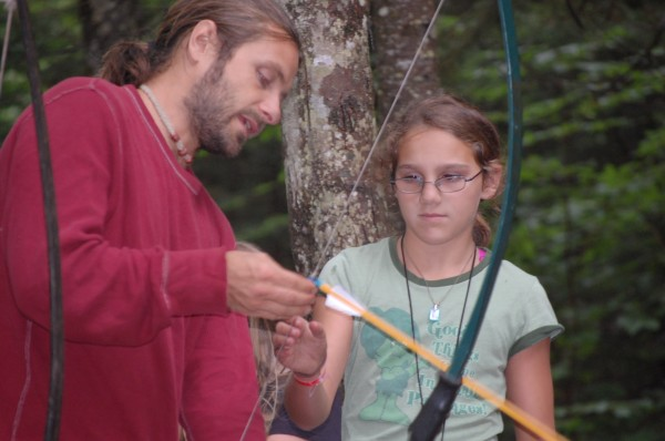 Adam Stone teaches archery at Camp Forest