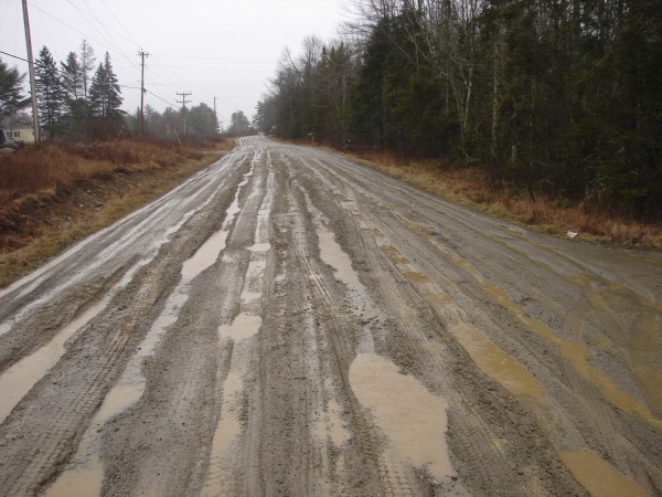 Several potholes can be seen on East Waldo Road in Waldo. One resident estimated there were more than 10,000 potholes.