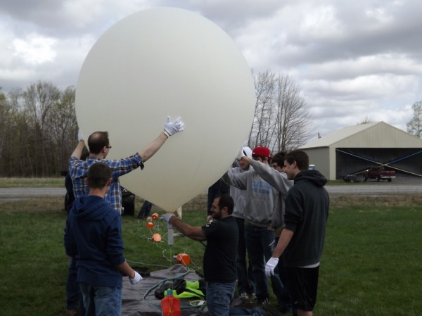 University of Maine High-Altitude Ballooning project students help inflate one of two balloons that were launched from Pittsfield Municipal Airport on Wednesday, April 25, 2012