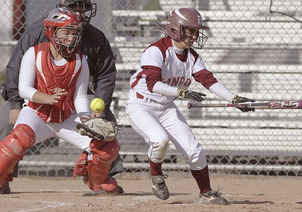Bangor center fielder Jade Baumrind (2) shows bunt as the Messalonskee catcher  Natalie Hunt tries to collect the loose ball in the second inning of their game  in Bangor on Tuesday, April 24, 2012.